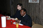 Paul Drake and Elias Mukasa enjoy dinner.